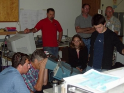 Teachers and HS students in the lab